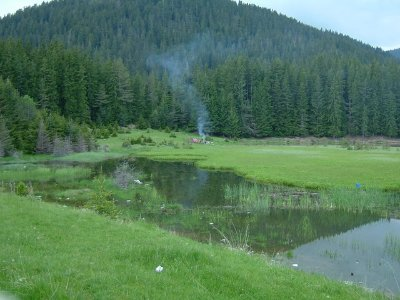 One end of the Lower Smolyan Lake with a log fire barbecue on the go