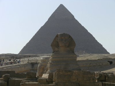 The Sphinx guarding  one of the Great Pyramids